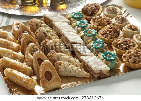 Dish with fresh baked Moroccan cookies served with tea - stock photo