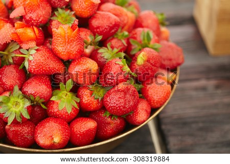 dish with fresh strawberries closeup
