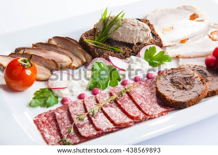 dish with meat appetizers and decoration