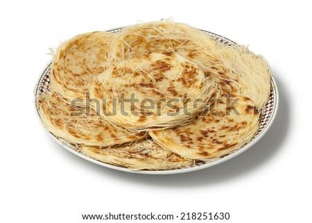 Dish with Moroccan special pancake Razat El Quadi on white background - stock photo