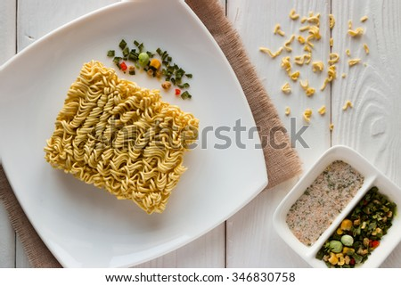 dish with noodles and spices on a napkin - stock photo