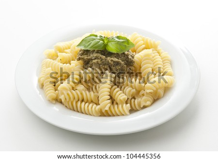 dish with pasta with pesto sauce on white background