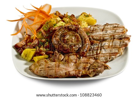 Dish with various meats and potatoes - isolated