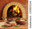 dishes of roast meat  in Russian cuisine  with an oven and a burning - stock photo