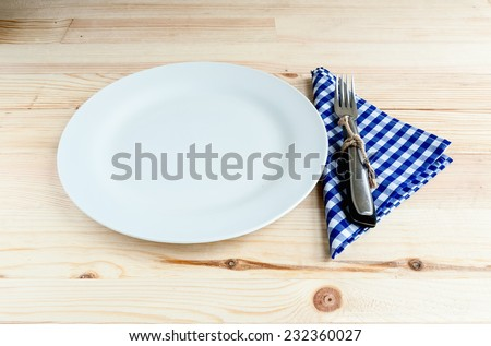 Dishes with fork knife and napkin