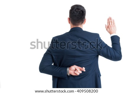 Dishonest lawyer making fake oath or pledge with fingers crossed behind back - stock photo