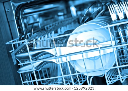 Dishwasher after cleaning process, blue tone