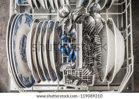 Dishwasher basket after cleaning process - stock photo