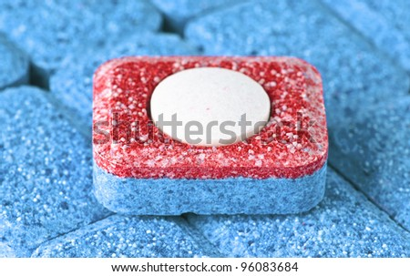 "dishwasher soap tablet ""all in one"" - stock photo"