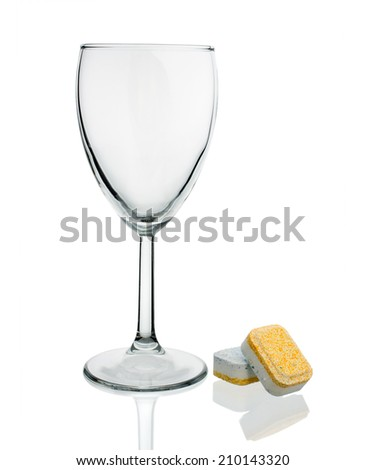 Dishwasher tablets with glass wine glasses on white background isolate - stock photo