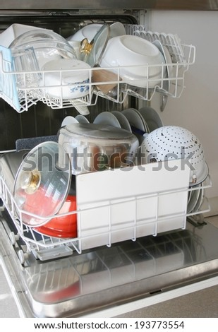 Dishwasher with clean dishes - stock photo