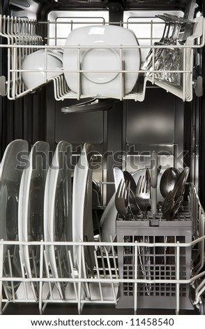 Dishwasher with clean white dishes