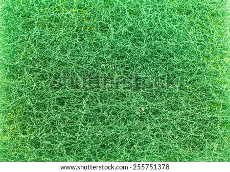 Dishwashing green sponge - stock photo