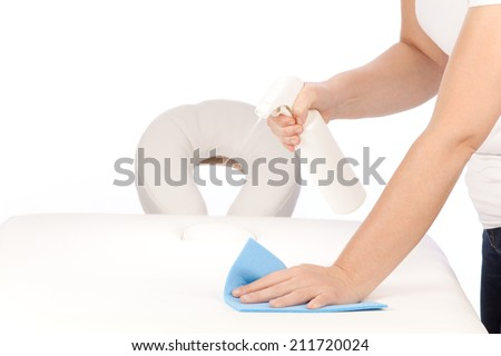 Disinfecting a massage table