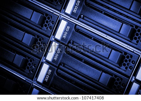 Disk array in datacenter with blank label. - stock photo