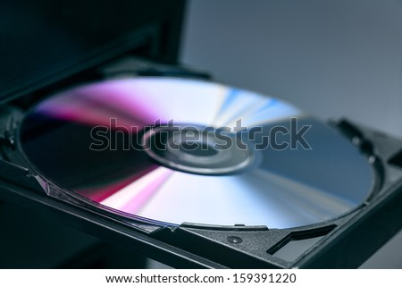 Disk in DVD-Rom. - stock photo