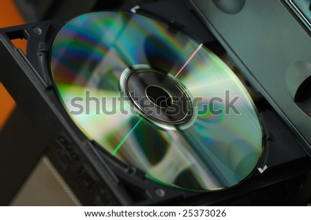 Disk in the drive. A photo close up CD of a disk