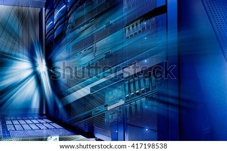 disk storage blades in mainframe server room - stock photo