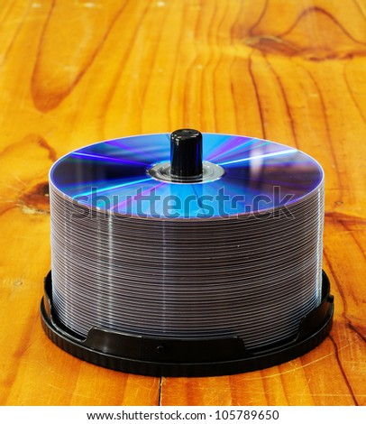 disks on wooden table