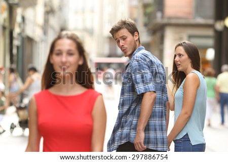 Disloyal man walking with his girlfriend and looking amazed at another seductive girl - stock photo