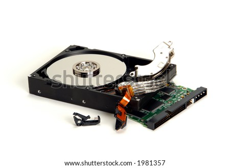 Dismantled and open crashed computer hard disc drive with loose parts and exposed hardware components after crash over white - stock photo