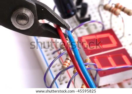 Dismantling electronic bomb - stock photo