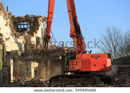 Dismantling of an old factory on a sunny day. - stock photo