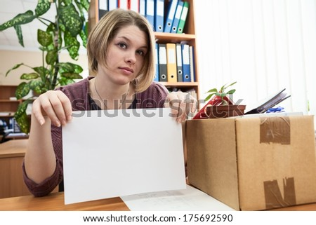 Dismissed worker with blank sheet of paper in the office - stock photo