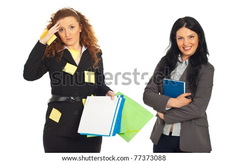 Disorganized business women with folders and reminder notes on her suit and organized smiling business woman holding personal agenda isolated on white background