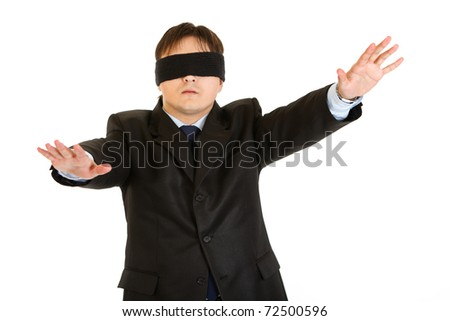 Disoriented businessman with blindfold covering his eyes  isolated on white - stock photo