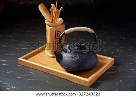 Display of ancient Chinese teapot on black background