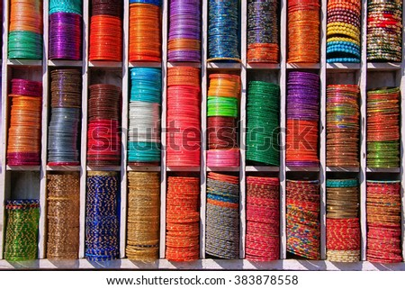 Display of colorful bangels at the street market in Jaipur, Rajasthan, India. - stock photo