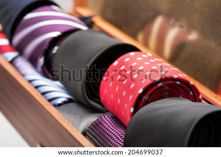 Display of different patterns and colours of man ties in a shop or showroom