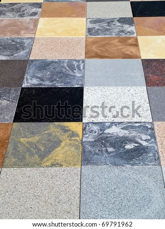 Display of different stone granite floor tiles for outdoors garden and indoors