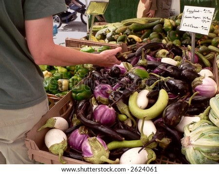 Display of eggplant at farmers' market. - stock photo