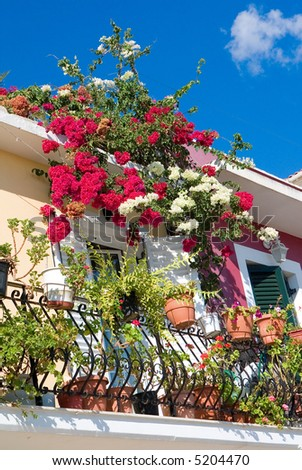 Display of flowers on balcony on building in Zakynthos, Greece
