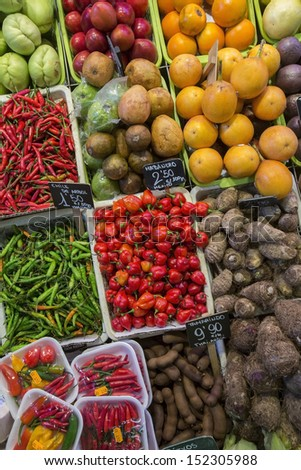 Display of fruit and vegetables in the famous St Joseph Food Market in the Eixample district of Barcelona in the Catalonia region of Spain. - stock photo