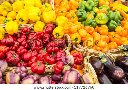 Display of peppers on display at the farmers market - stock photo
