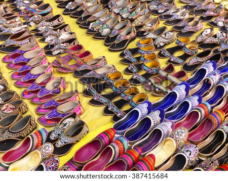Display of traditional shoes at the street market in Jaipur, India. Jaipur is the capital and the biggest city of Rajasthan. - stock photo