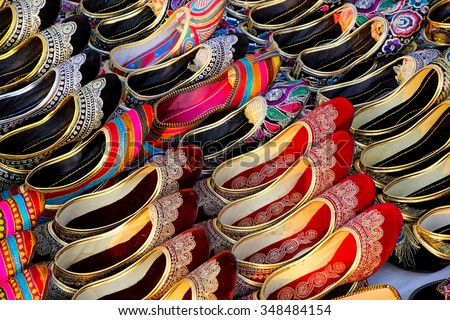 Display of traditional slippers at the market, Jaipur, India - stock photo