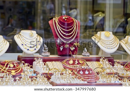 Display of various jewelry in store window - stock photo