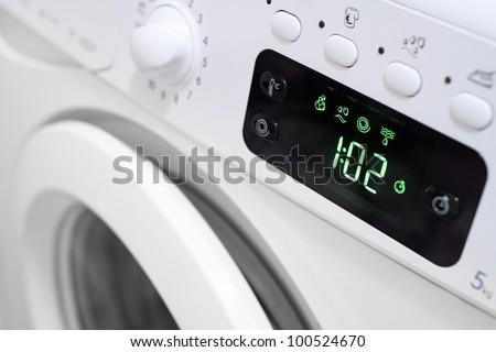 Display washing machine. Macro photo part of modern home washing machine - stock photo