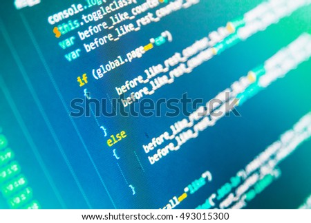 Displaying program code on computer. Developer working on websites codes in office. Monitor closeup of function source code. Javascript functions, variables, objects.