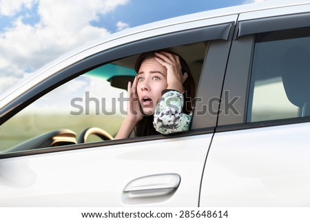 Displeased angry woman driving her car.Negative human expression.