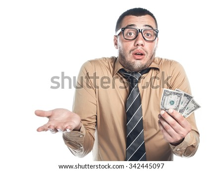 Displeased businessman count - holding money -wages or payout, isolated on white background. Employee young man with small profit. Bankruptcy concept, finacial crisis.