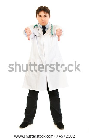 Displeased medical doctor showing thumbs down gesture isolated on white