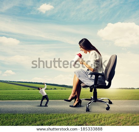 displeased screaming woman and scared man on the road - stock photo