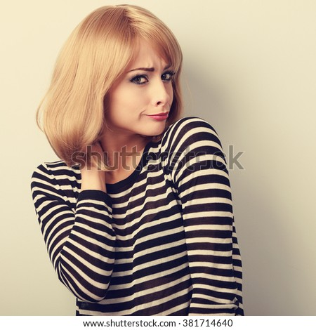 Displeased suspicious blond woman looking skeptical. Toned closeup portrait - stock photo