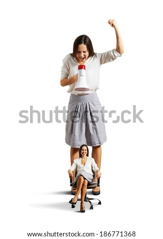 displeased woman and smiley calm woman over white background - stock photo