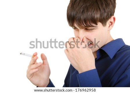 Displeased Young Man with Cigarettes closing the Nose. Isolated on the white background - stock photo